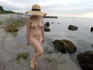 Naked girl walks along the beach - Public beach vacation without clothes - exhibitionist wife beach