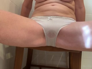 Blonde Wife peeing through panties with flash of pussy at the end.