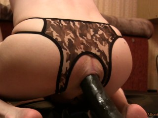 Femboy fucks with a Sex Machine, side view, close up