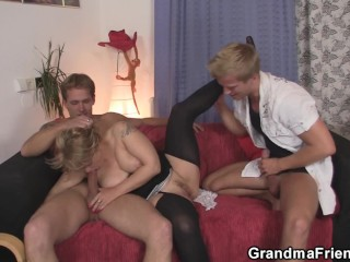 Sexy old lady take two cocks from both sides