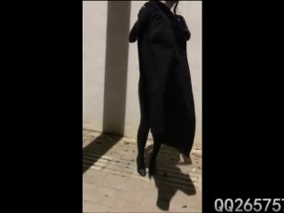 Latex Girl Wearing Vibrator and Walking Outside